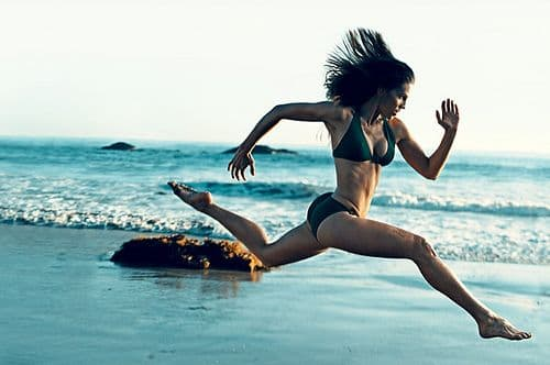 hilary swank running on beach